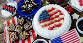 tatarak : Fruitcake and various sweet foods arranged on wooden table with 4th July theme