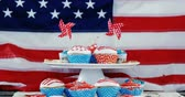 tatarak : Decorated cupcakes with 4th july theme against American flag Wideo