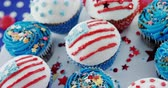 tatarak : Close-up of cupcakes decorated with 4th july theme on wooden table