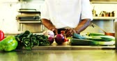 spring onion : Chef cutting vegetables in commercial kitchen at restaurant