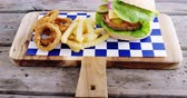 chili ring : Close-up of hamburger, onion ring and french fries on chopping board