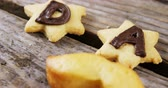 indulgence concept : Close-up of star shape cookies with text dad on arranged wooden plank