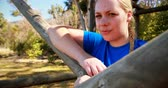 wellbeing : Portrait of determined woman relaxing on outdoor equipment during obstacle course Stock Footage