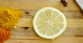 citrus fruit recipe : Close up of various spices with lemon slice and knife on chopping board 4k Stock Footage