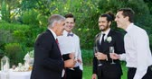 groomsmen : Father of the Bride having champagne with groom and guest at wedding 4K 4k Stock Footage