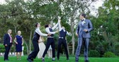 groomsmen : Garter toss by happy groom and groomsmen catch it at wedding 4K 4k