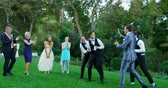 groomsmen : Groom and groomsmen enjoying catching Garter toss at wedding 4K 4k
