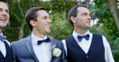 groomsmen : Close-up of groom and groomsmen happily hugging, talking 4K 4k Stock Footage