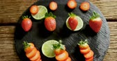citrus fruit recipe : High angle view of strawberries and lemon placed on wooden surface 4K 4k