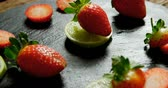 citrus fruit recipe : Close-up of sliced strawberries and lemon on round tray 4K