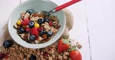 mirtilos : Close-up of healthy breakfast in a bowl on white background 4k Stock Footage