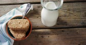 fibers : Close-up of granola bar and milk on a wooden table 4k Stock Footage