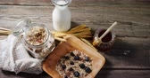 édesítőszer : Close-up of breakfast cereals and jar of honey on wooden table 4k