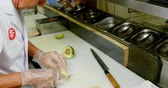 indulgence : Male chef cutting avocado fruit in kitchen at restaurant 4k