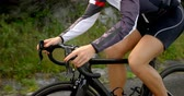 concorrente : Close-up of female cyclist cycling on a countryside road 4k