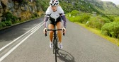 concorrente : Close- Up of female cyclist cycling on a countryside road 4k