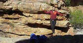 slackline : Highline athlete walking on slackline in rocky mountain 4k
