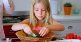 picada : Girl preparing salad in kitchen at home 4k Stock Footage