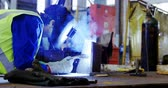 hegesztő : Male engineer using welding torch in workshop 4k Stock mozgókép