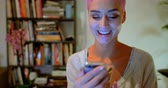 nose ring : Smiling pink hair woman using mobile phone at home 4k Stock Footage