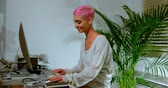 nose ring : Pink hair woman working on computer in office 4k