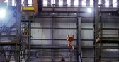 conhecimento : Modern hoist machine hanging in workshop 4k