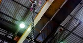 oficina : Modern hoist machine hanging in workshop 4k