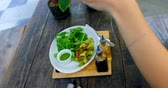 high speed camera : Woman photographing salad on the table in restaurant 4k