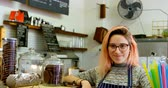 kafeterya : Portrait of beautiful waitress standing at the cafe counter 4k Stok Video