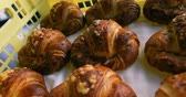 bakery shop : Baked croissant arranged in a basket on parchment paper 4k