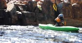 parked : Woman kayaking in the river on a sunny day 4k Stock Footage
