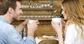 pires : Couple having coffee at counter in cafe 4k Stock Footage