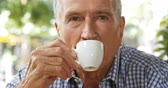 coffee cup : Active senior man having coffee in cafe 4k Stock Footage
