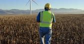 jacket : Rear view of male engineer walking in the wind farm 4k Stock Footage