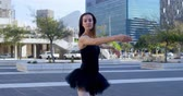tüt : Ballet dancer performing on the pavement in city 4k