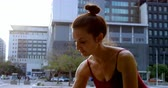 tüt : Close-up of female ballet dancer performing on pavement in the city 4k Stok Video