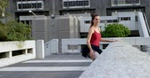 tüt : Ballet dancer stretching on pavement in city 4k