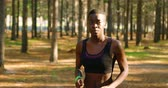 stamina : Woman jogging in the forest on a sunny day 4k