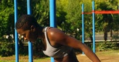 ser humano : Female athlete relaxing after workout in the park on sunny day 4k