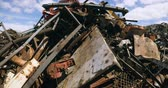 atık : Rusty metal pieces in scrapyard on a sunny day 4k Stok Video