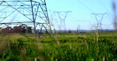 alternative energy : High voltage electric poles on farmland 4K 4k