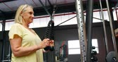 determined : Determined senior woman doing triceps exercise in fitness studio 4k Stock Footage