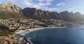 континент : Houses and mountain ranges along the sea coast 4k Стоковые видеозаписи