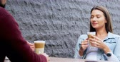 kafeterya : Couple interacting to each other at outdoor cafe 4k