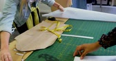 tekstil : Fashion designers working on table in fashion studio 4k Stok Video