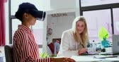 digitalizador : Fashion designers using virtual reality headset and graphic tablet in fashion studio 4k Stock Footage