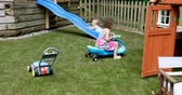 mixed race person : Siblings playing near play house at backyard 4k