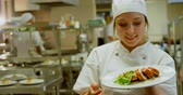 stuffing : Smiling female chef holding dish and showing ok sign 4k
