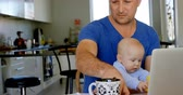 pato real : Father using laptop while baby boy playing with toy at home 4k