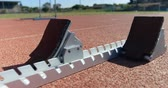 bloklar : Close-up of starting blocks on a running track 4k